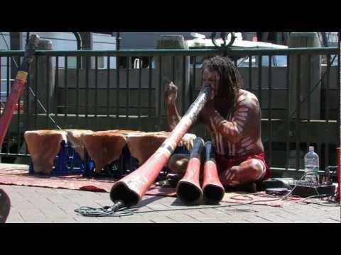 Aboriginal guys playing Didgeridoo music at Circular Quay, Sydney HD footage