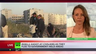 Syrian rebels shoot at civilians as they flee to govt held areas