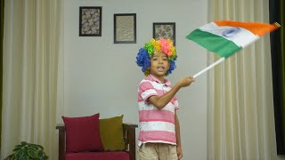 Smiling young kid hosting Indian National tricolor flag - Independence Day or Republic Day