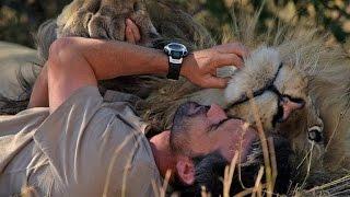 Man Cuddles with a Lion thumbnail