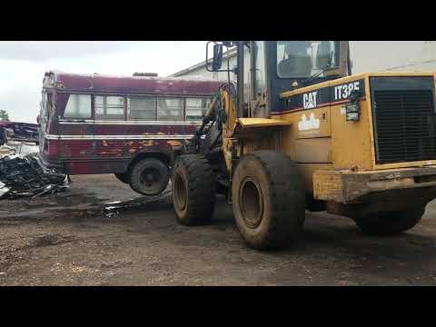 How to crush  an old school bus at our salvage yard, part#1