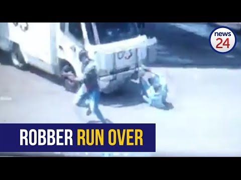 WATCH: Robber run over by cash in transit vehicle