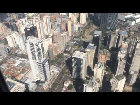Landing in São Paulo city, Congonhas airport. Flying low over skyscrapers.