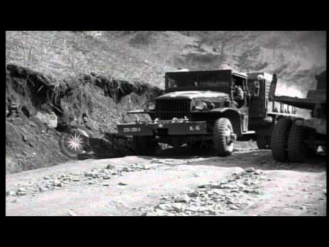 US Army Supply Trucks Come Up Road Trail In The Kachil-Bong, Korea During Korean ...HD Stock Footage