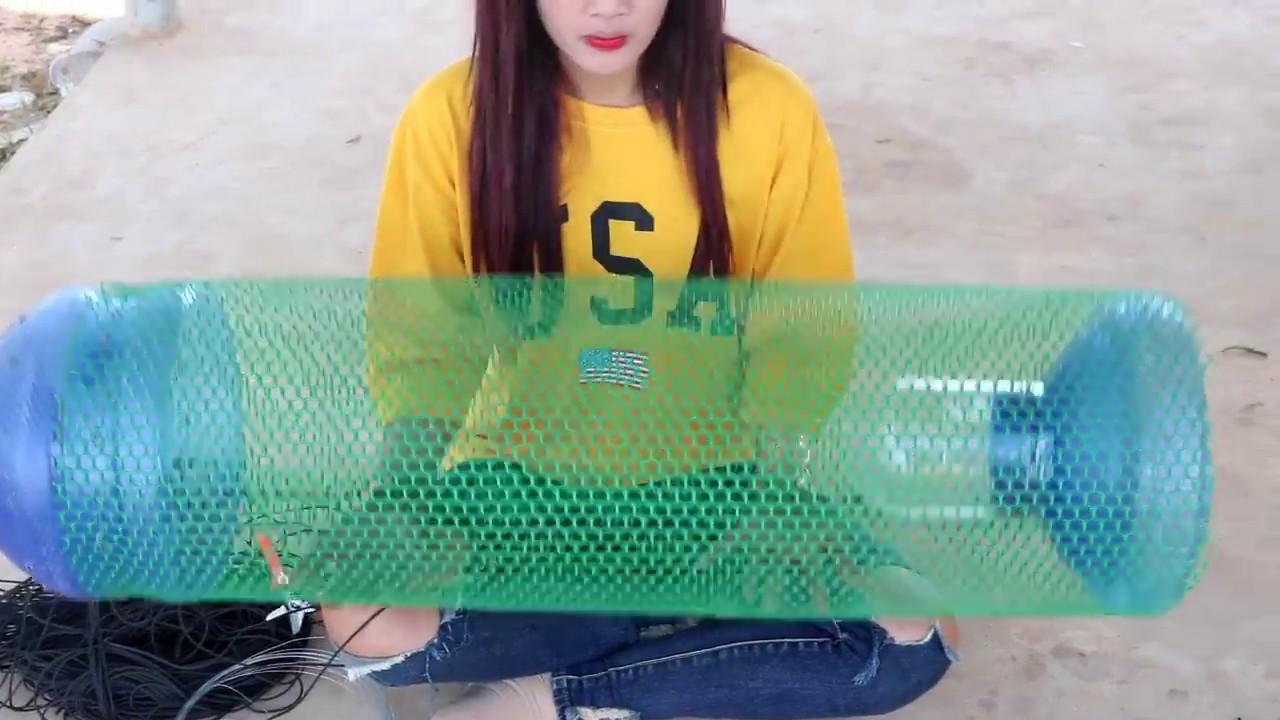 Creative girl make fish trap using big plastic bottle to for How to make a fish trap for big fish