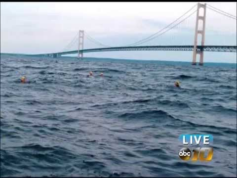 NMU swimmers swim across the Straits of Mackinac