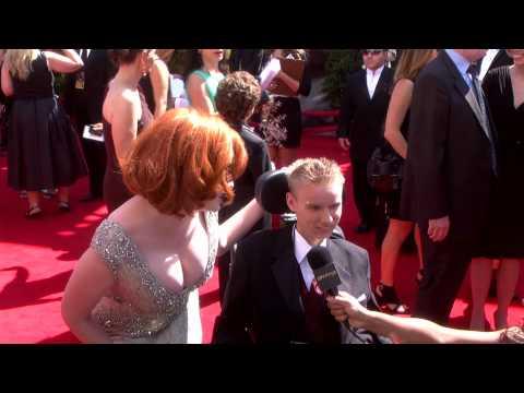 Christina Hendricks with Make-a-Wish's David: Red Carpet Primetime Emmys 2011