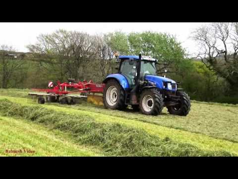 Raking and Baling Grass for Silage - New Holland Action.