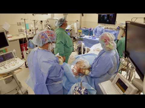 photo of a man in the simulator operating room looking at supplies