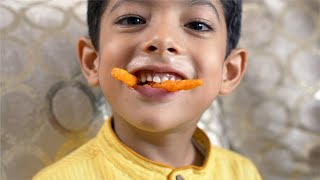 Naughty Indian boy makes monster teeth with french fries