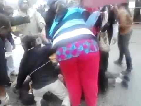 Three people get run over by a car during a fight at ...