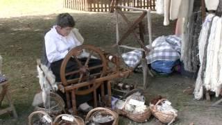 Lady spinning Pyrenean dog wool Argeles Gazost 2014 (short version)
