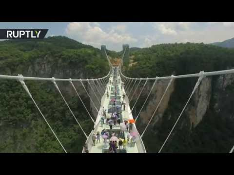 Don't crack it! Worlds longest glass bottom bridge opens in Hunan, China