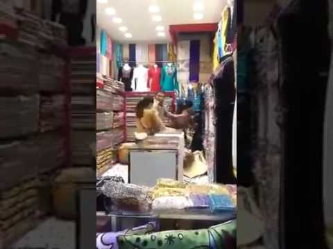 Fight Between Afghan Shopkeeper And Philippine Girl In Dubai....!!!