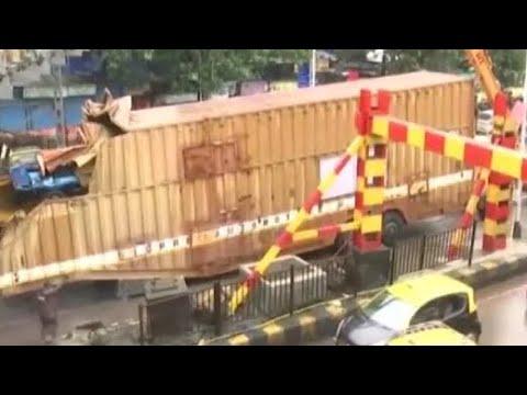 Download Container Truck Stuck Under Railway Bridge Triggers Traffic Jam In Mumbai