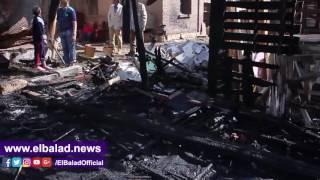 18 سيارة إطفاء للسيطرة على حريق سوق التونسى.. فيديو وصور