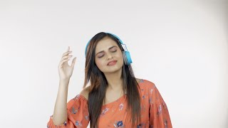 Modern happy girl listening to Bollywood or Hollywood songs with her headphones