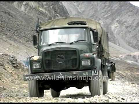 Indian Army troops in trucks travel as a convoy in Himalaya, to Indo-Chinese border