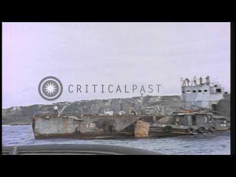 Remains of the USS Gamble (DM-15) being  towed out to sea for scuttling, near end...HD Stock Footage