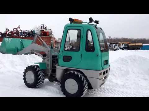 Японский фронтальный погрузчик Mitsubishi WS310 с ковшом - убирает снег, улучшает жизнь.