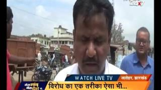 People protested by cultivating rice on NH 99 in Latehar, Jharkhand