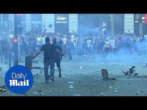 France fans scuffle with police in Paris following World Cup win - Daily Mail
