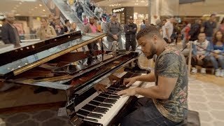 Amazing street pianist stขns passersby in shopping centre