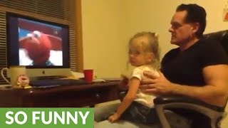 Little girl scolds dad for laughing at Elmo