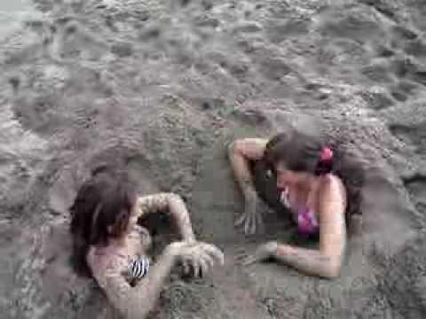 peeing sand Girl