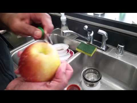 Wax removal from apple. Cleaning apples.