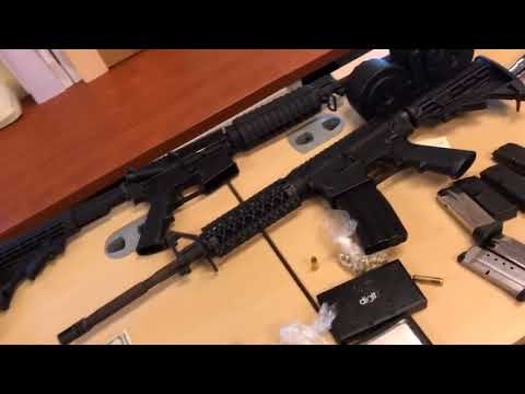 Cache of guns, cash and drugs seized after attack in Mass.