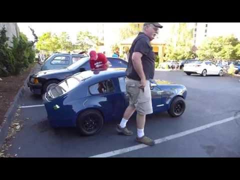 Big Men in Little Cars