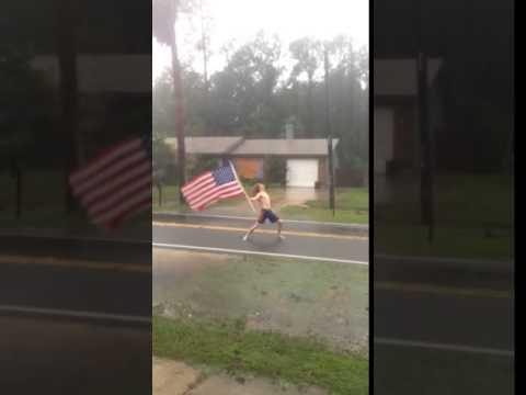 Florida Man waves American Flag during Hurricane Matthew