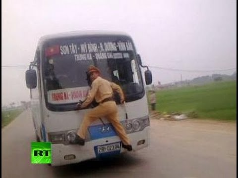 Download Video: Vietnam cop clings to speeding bus windshield wipers