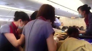 Baby girl born mid-flight at 30,000 feet