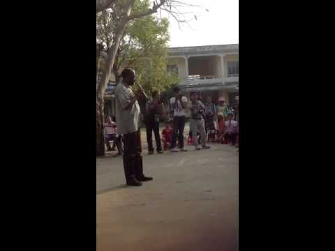 Anthony Brown sings to children in My Lai Vietnam