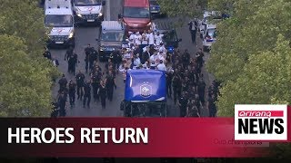 Thousands gather in Paris to welcome back World Cup champions