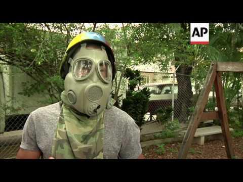 Venezuelans clash with police in Caracas