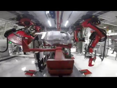 Tesla receives massive shipment of robots for Model 3 production line – first pictures