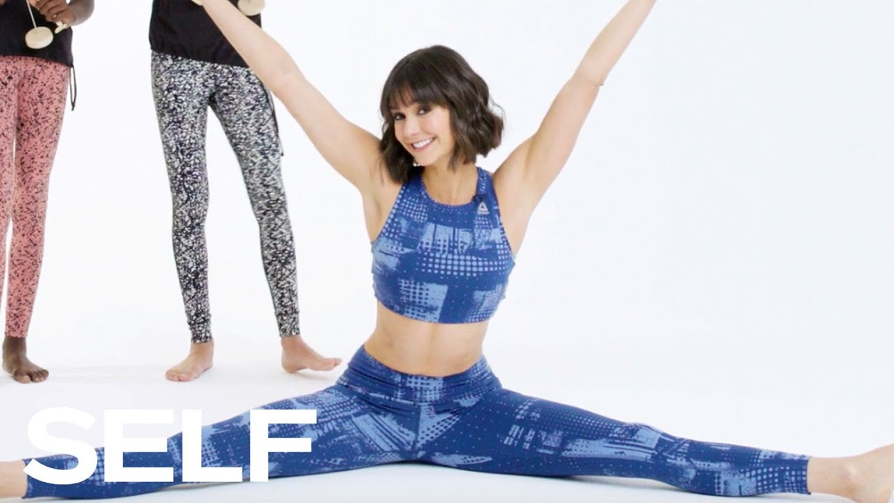 Nina Dobrev Shows Off Her Flexibility | SELF