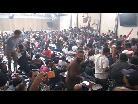 Iraqi protesters storm parliament building in Baghdad