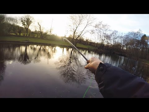 Fishing in Winter from a Log Cabin