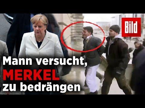 Kurz nachdem sie gewählt wurde – Mann versucht, Angela Merkel zu bedrängen
