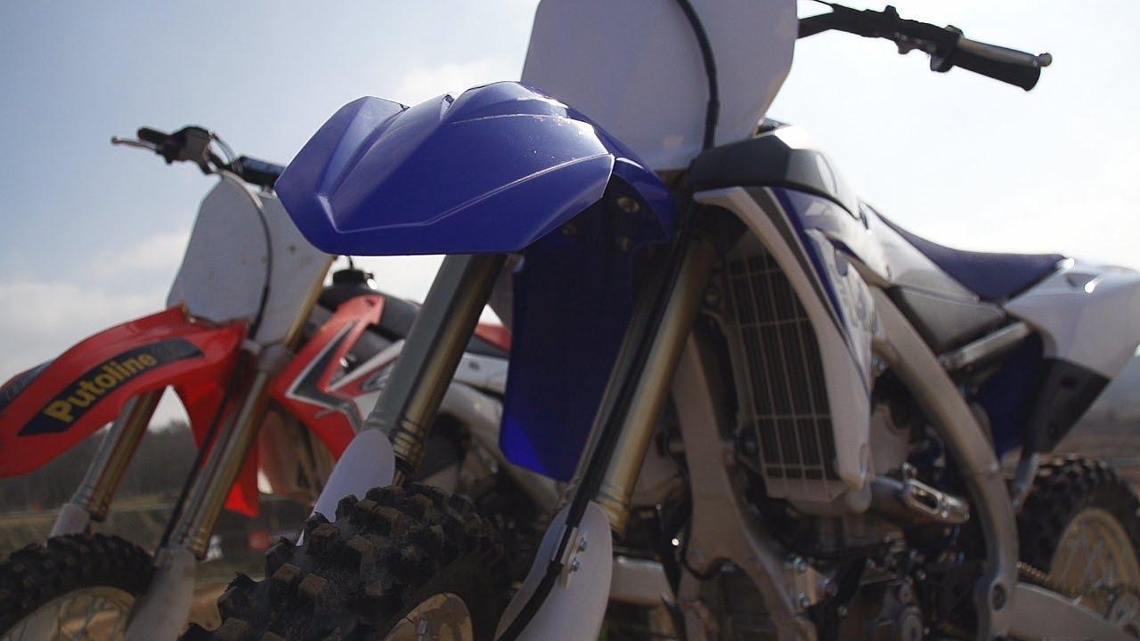 Video: 2014 Yamaha YZ450F vs Honda CRF 250 bike test