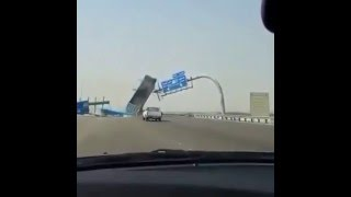 Dumb Driver Dump trunk hits free way sign