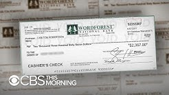 "Fake check scams ""exploding epidemic,"" new report says"
