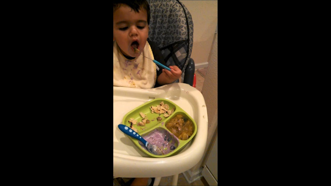 15 month old Max eats his dinner with a spoon for the first time (Warning:  very messy)