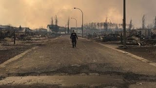 Fort McMurray wildfire: Friends, strangers, refugees compelled to help