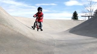 A 3 year old and his Strider bike in the skate park (Strider bikes rule!)