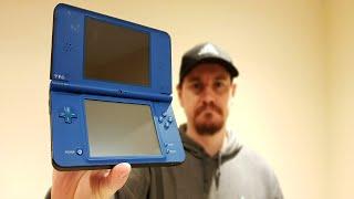 Nintendo DSi XL Orange Light o…